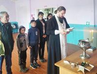 Гуманитарный склад Томской епархии передал вещевую помощь в отдаленные деревни Тегульдетского района